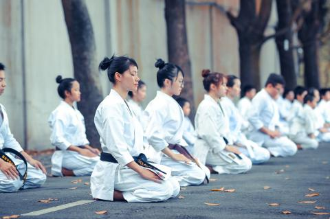 people dressed in karate suits kneeling