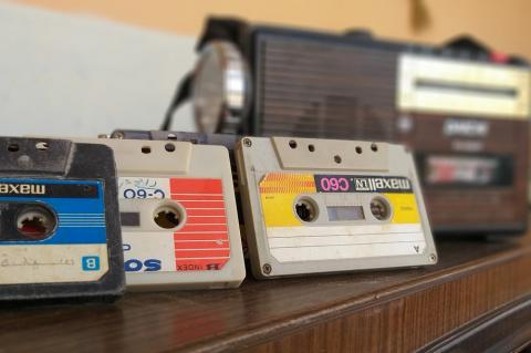 casettes with a player in a row